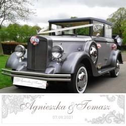 Tablica rejestracyjna na samochód ślubny. Grafika ze srebrnym ornamentem i imionami Pary Młodej.