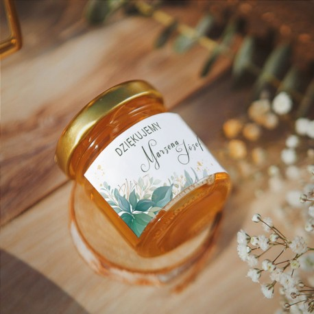 MIÓD podziękowanie dla gości weselnych. Etykieta z zielonymi listkami i imionami Pary Młodej. Złota nakrętka na mini słoiczku.