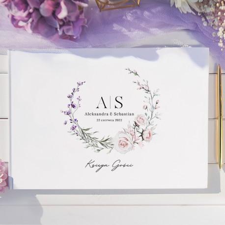 Księga na wpisy od gości weselnych. Okładka wzbogacona o motyw z grafiką wianuszka.
