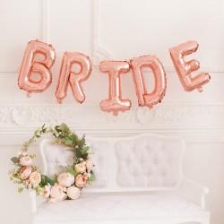 Foliowe balony na wieczór panieński w postaci napisu bride w kolorze różowego złota.
